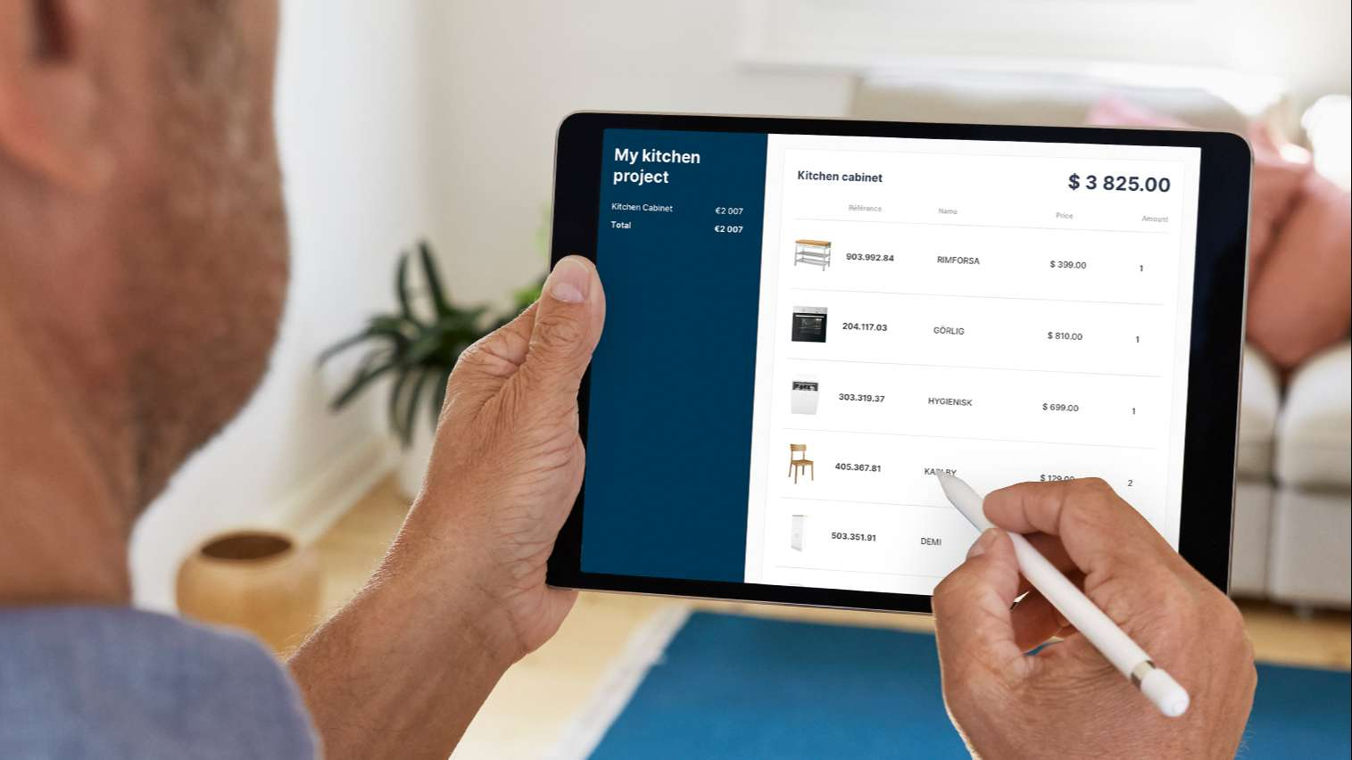 man updating his kitchen project price list on a tablet with the HomeByMe for Kitchen Retailers 3D planning solution