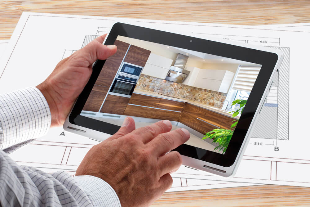 designer planning a kitchen using HomeByMe for Kitchen Retailers 3D planning solution