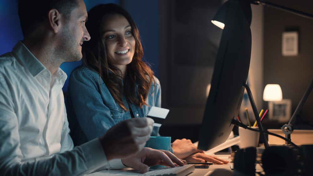 couple paying online with credit card