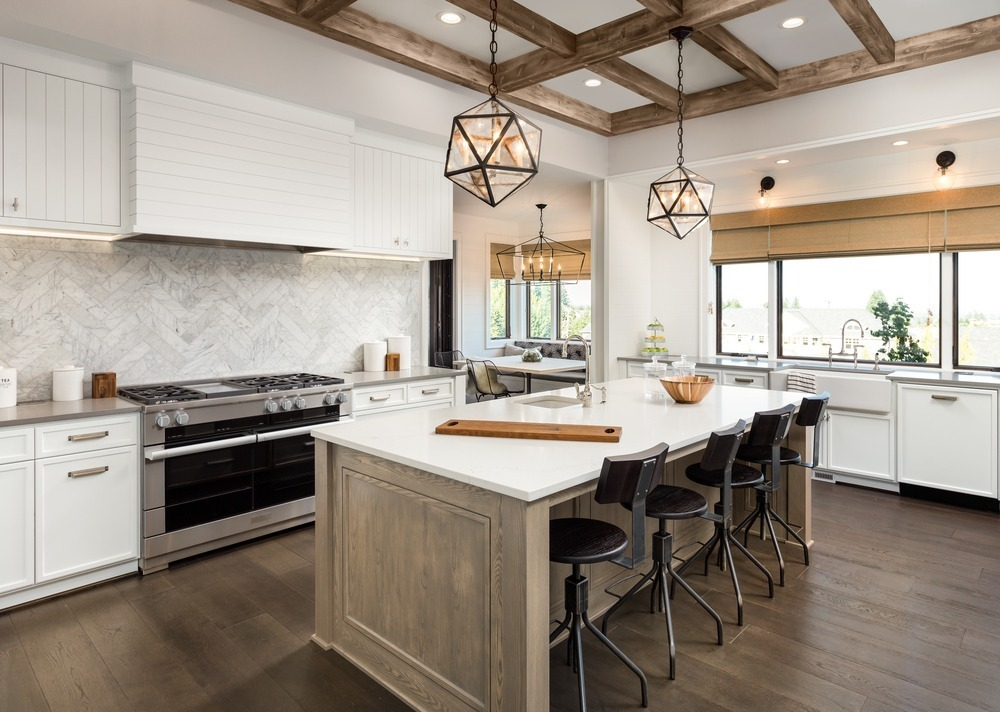 large kitchen with white countertop island