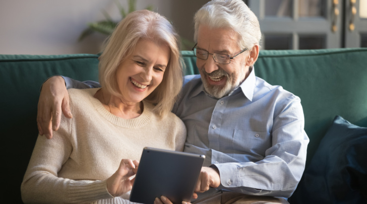 elderly couple designing on a tablet